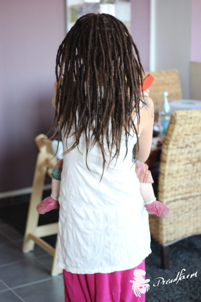 Girl with Dreadlocks and Baby